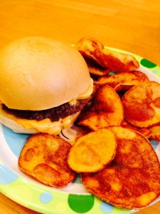 hamburger, scharrs bun, daiya cheese and home made chips