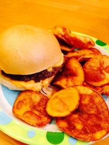 hamburger, scharrs bun, daiya cheese and home made chips